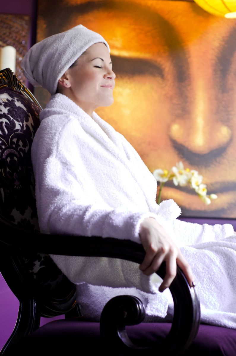 Happy, relaxing client after facial & waxing